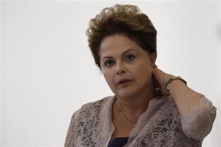 Brazil's President Rousseff reacts during an announcement contracting for new sanitation services of PAC2 (Growth Acceleration Program) to municipalities with up to 50,000 inhabitants, at the Planalto Palace in Brasilia