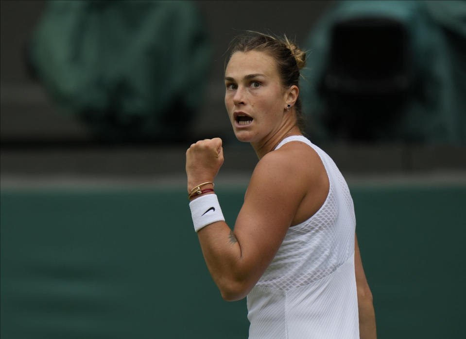 Belarus's Aryna Sabalenka celebrates winning a point against Britain's Katie Boulter during the women's singles second round match on day three of the Wimbledon Tennis Championships in London, Wednesday June 30, 2021. (AP Photo/Alastair Grant)