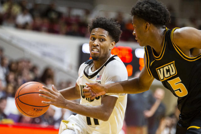 Purdue guard Isaiah Thompson (11) drives against Virginia Commonwealth guard Nah'Shon Hyland (5) in the first half of an NCAA college basketball game at the Emerald Coast Classic in Niceville, Fla., Friday, Nov. 29, 2019. (AP Photo/Mark Wallheiser)