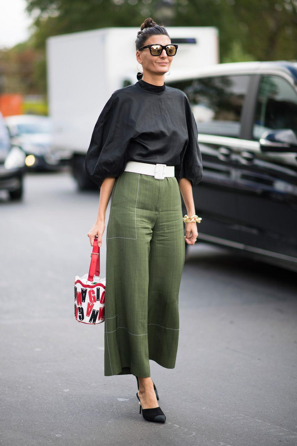 <p>In one of her more understated looks, Battaglia created a Balenciga-inspired shape in her cropped khaki culottes and high-neck black shirt in September 2016. She added signature playfulness with a colourful logo bucket bag.</p>