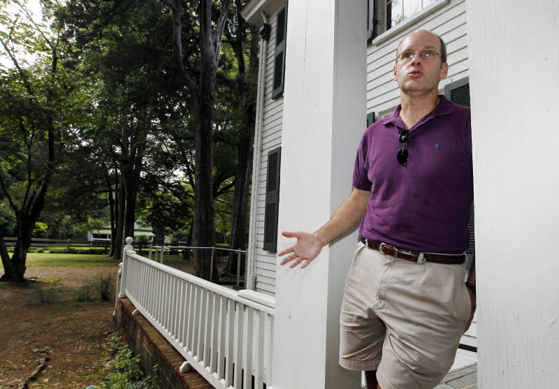 In this June 8, 2012 photograph, Jay Watson, professor of Faulkner Studies at the University of Mississippi, stands on the porch at Roan Oak, the home of the late Nobel Prize laureate William Faulkner, in Oxford, Miss., and discusses his role in American literature. The home is owned and maintained by the university as a museum. (AP Photo/Rogelio V. Solis)