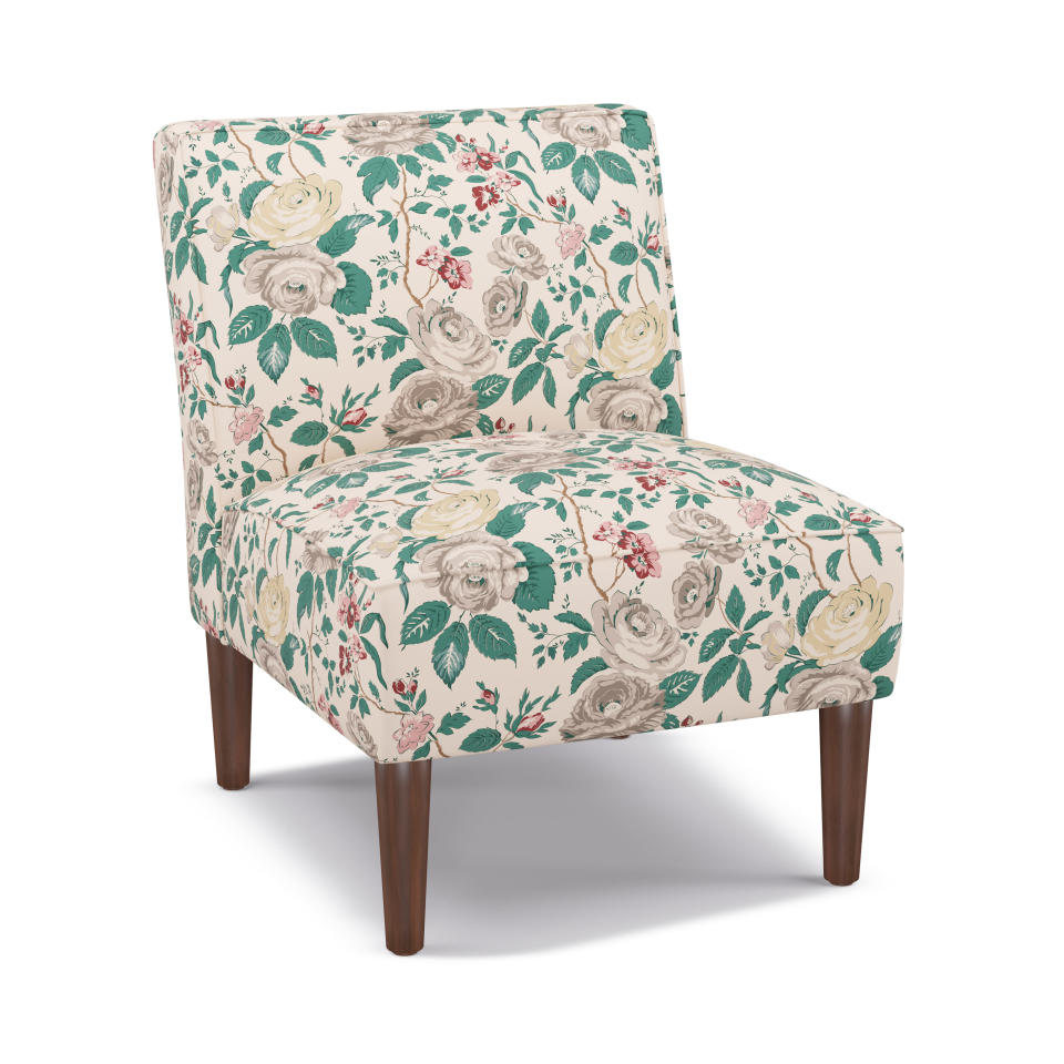 """This photo provided by The Inside shows their Slipper Chair. """"Interiors been clean, mid-century-inspired and fairly generic for the past few years,"""" says Christiane Lemieux, the founder of DwellStudio who now runs custom furniture retailer The Inside. """"Now people are craving the 'new and more'. Enter Maximalism, specifically through the lens of British design, which is experiencing a major revitalization."""" One feature of the trend: updated versions of chintz. Slipper chairs and wingback beds are some of the chic ways to bring the look home. (The Inside via AP)"""