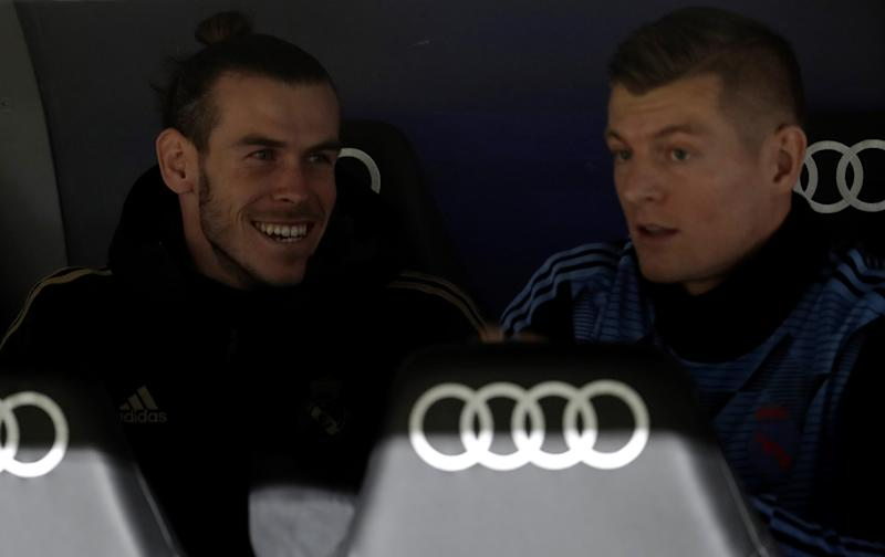 MADRID, SPAIN - NOVEMBER 23 : Gareth Bale (L) and Toni Kroos (R) of Real Madrid chat at substitutes' bench during the Spanish league (La Liga) football match between Real Madrid CF and Real Sociedad at the Santiago Bernabeu Stadium in Madrid, Spain on November 23, 2019. (Photo by Burak Akbulut/Anadolu Agency via Getty Images)
