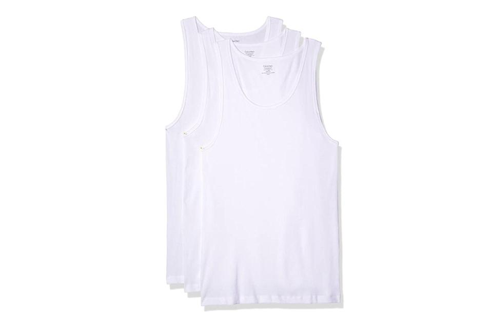 """Come summertime, pair one of these with an open-collared shirt and a slim chain necklace, and you've got yourself a *Sopranos*-certified fit.<br> <br> <em>Calvin Klein cotton classics multipack tanks</em> $28, Amazon. <a href=""""https://www.amazon.com/dp/B00JQRPWHY/ref=twister_dp_update?_encoding=UTF8&psc=1"""" rel=""""nofollow noopener"""" target=""""_blank"""" data-ylk=""""slk:Get it now!"""" class=""""link rapid-noclick-resp"""">Get it now!</a>"""