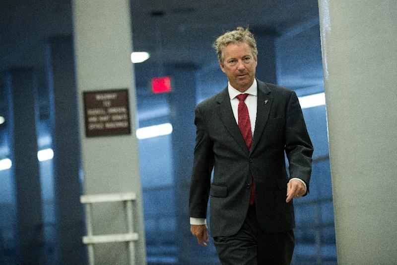 It was unclear what prompted Republican Senator Rand Paul's neighbor to allegedly tackle him from behind
