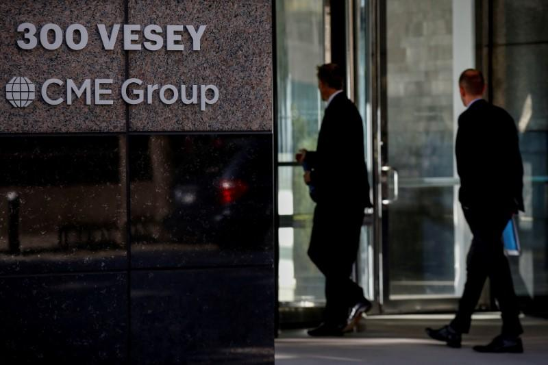 FILE PHOTO: Men enter the CME Group offices in New York