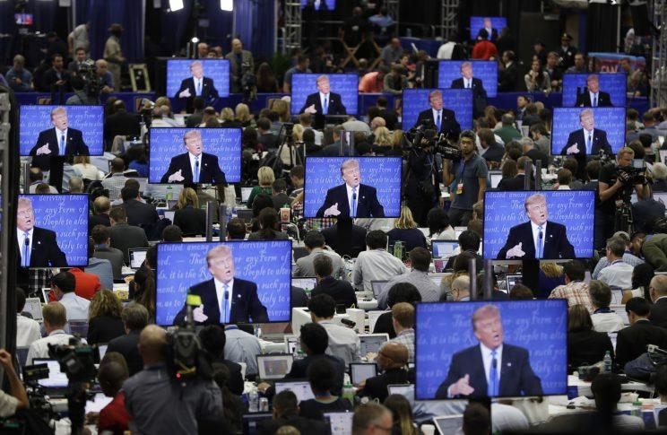 Donald Trump on multiple screens at the media center during the first presidential debate, at Hofstra University, Sept. 26, 2016. (Photo: John Locher/AP)