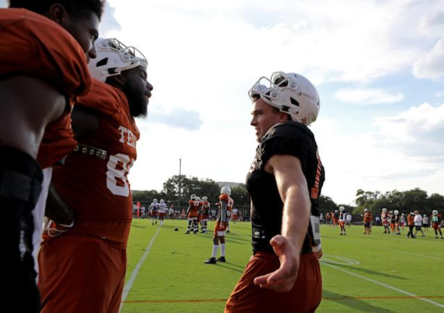 Texas Longhorns John Burt (from left) and Malcolm Epps talk with quarterback Sam Ehlinger during practice Wednesday Sept. 4, 2019 in Austin, Tx. ( Photo by Edward A. Ornelas )