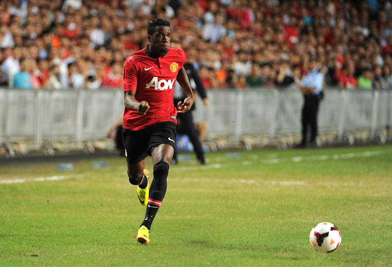 Wilfried Zaha controls the ball during a football friendly match in Hong Kong on July 29, 2013