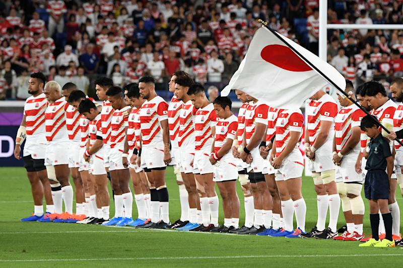 Japan's players observe a moment of silence for victims of typhoon Hagibis before the Japan 2019 Rugby World Cup Pool A match between Japan and Scotland at the International Stadium Yokohama in Yokohama on October 13, 2019. (Photo by William WEST / AFP) (Photo by WILLIAM WEST/AFP via Getty Images)