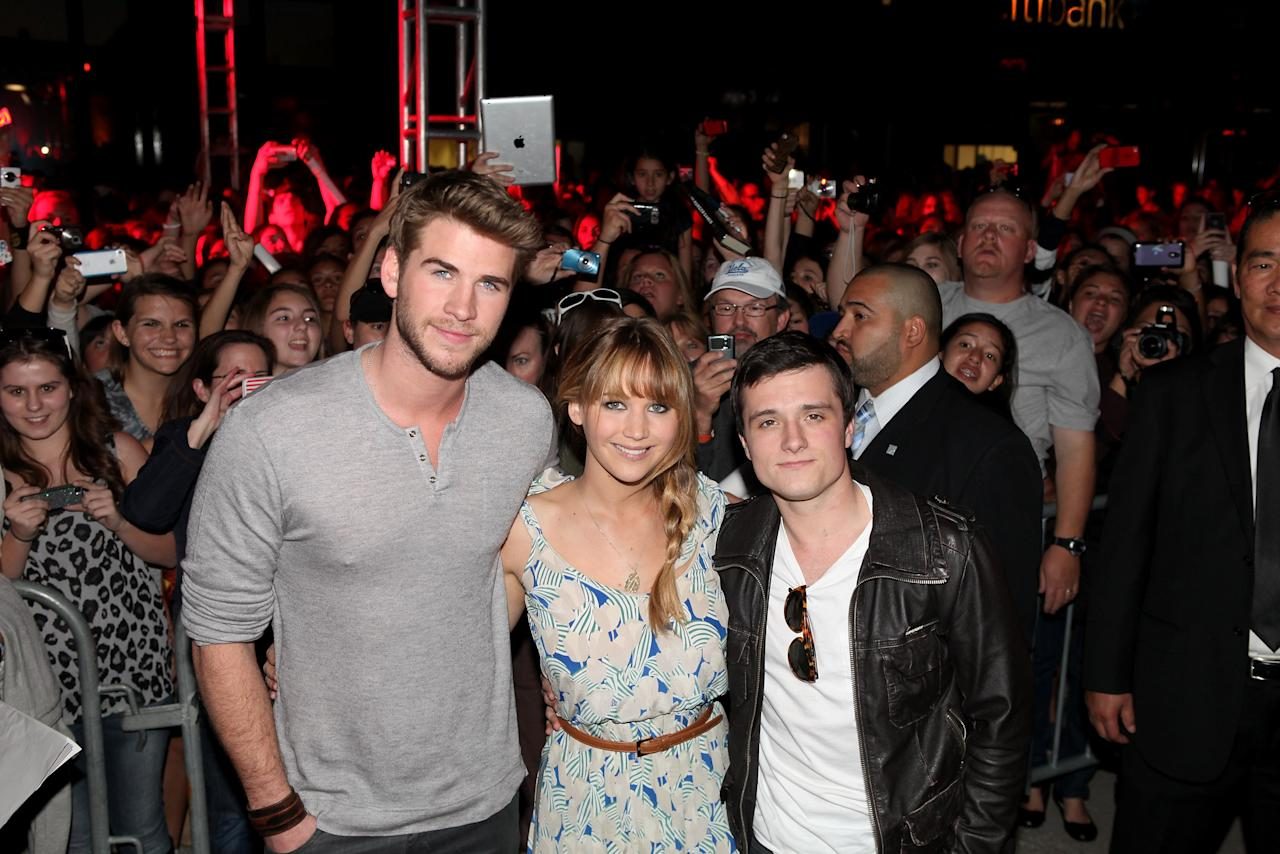LOS ANGELES, CA - MARCH 03: Actors Liam Hemsworth, Jennifer Lawrence and Josh Hutcherson attend The Hunger Games U.S. Mall Tour Kick-Off at Westfield Century City on March 3, 2012 in Los Angeles, California.  (Photo by Jesse Grant/Getty Images for Lionsgate)