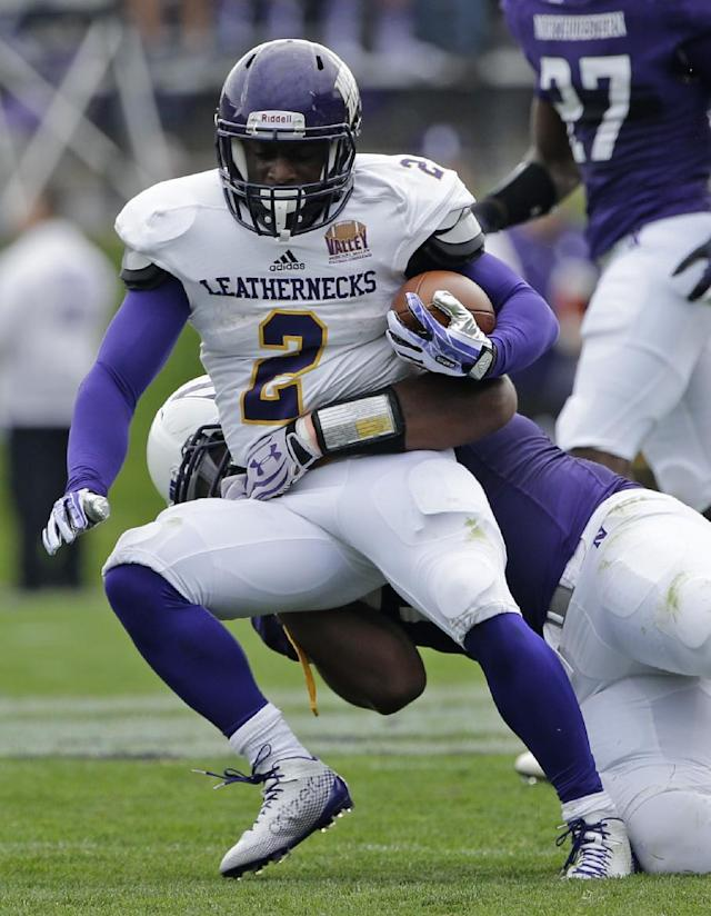 Northwestern defensive line Chance Carter (99) tackles Western Illinois running back J.C. Baker (2) during the first half of an NCAA college football game in Evanston, Ill., Saturday, Sept. 20, 2014. (AP Photo/Nam Y. Huh)