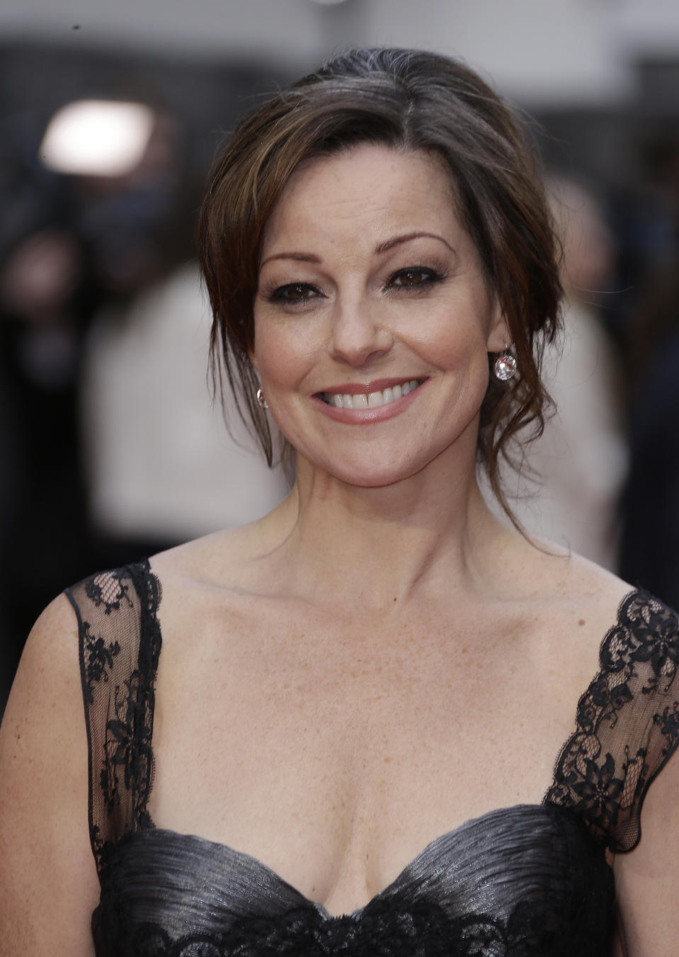 Ruthie Henshall poses for photographers upon arrival at the Olivier Awards at the Royal Opera House in central London, Sunday, April 12, 2015. The Laurence Olivier Awards are presented annually by the Society of London Theatre to recognise excellence in professional theatre and were renamed in honour of the British actor, in 1984. (Photo by Joel Ryan/Invision/AP)