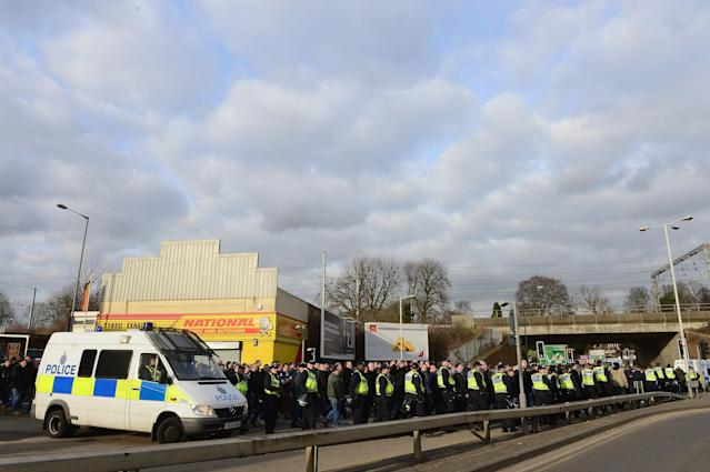 LUTON, ENGLAND - FEBRUARY 16: Police escort the Millwall fans to the station during the FA Cup with Budweiser firth round match between Luton Town and Millwall at Kenilworth Road on February 16, 2013 in Luton, England. (Photo by Jamie McDonald/Getty Images)