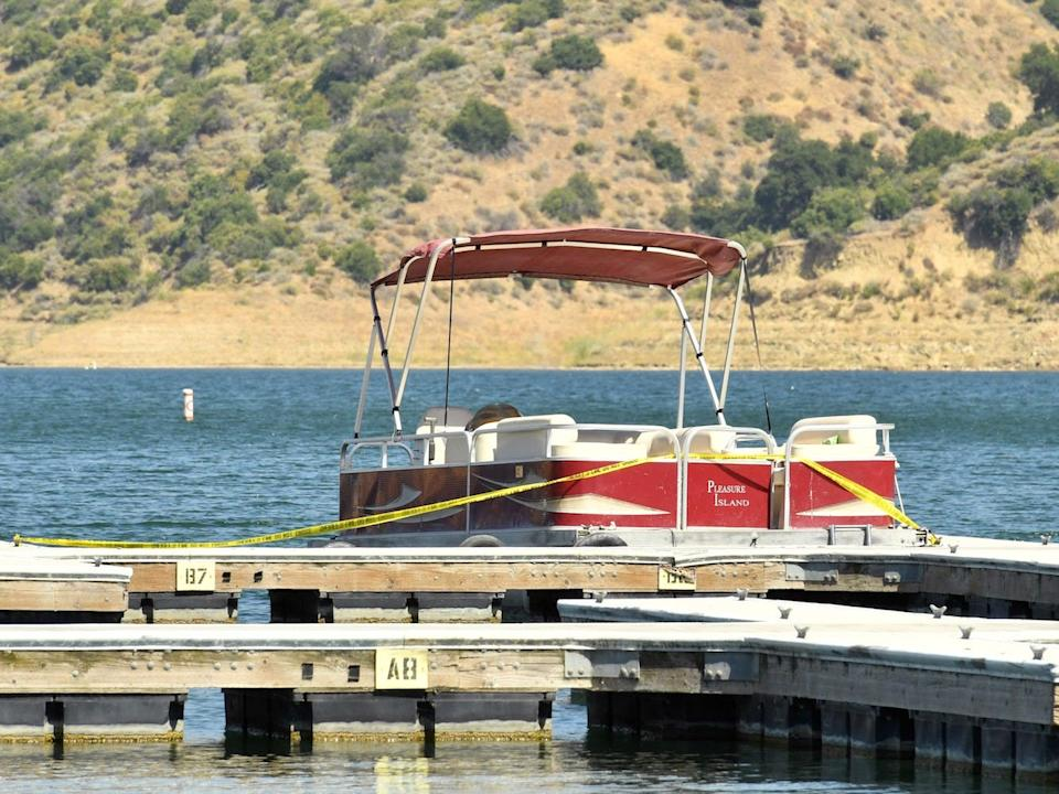 A boat is docked and roped off with police tape at Lake Piru, where actress Naya Rivera was reported missing Wednesday, on July 9, 2020.