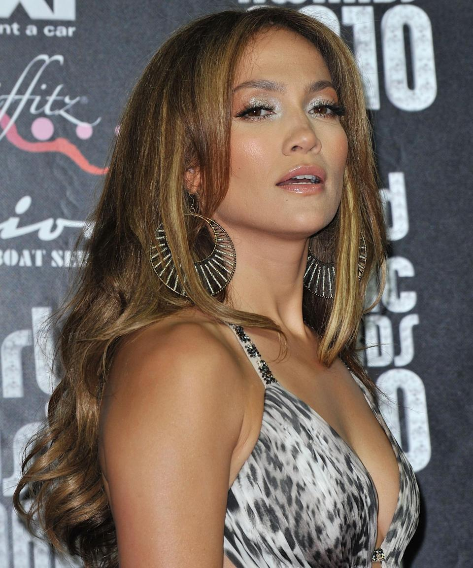 """<strong><h3>2010</h3></strong><br>J.Lo's glow is more commonly associated with shades of bronze and gold, but at the 2010 World Music Awards, she showed us that metallic gunmetal eyeshadow is equally striking.<span class=""""copyright"""">Photo: Pascal Le Segretain/Getty Images.</span>"""