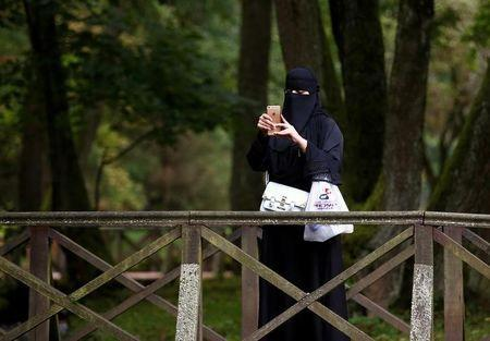 A tourist from the Middle East takes pictures at Vrelo Bosne nature park in Ilidza near Sarajevo, Bosnia and Herzegovina, August 19, 2016. REUTERS/Dado Ruvic