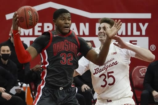 Ohio State's E.J. Liddell rebounds over Wisconsin's Nate Reuvers during the second half of an NCAA college basketball game Saturday, Jan. 23, 2021, in Madison, Wis. (AP Photo/Morry Gash)