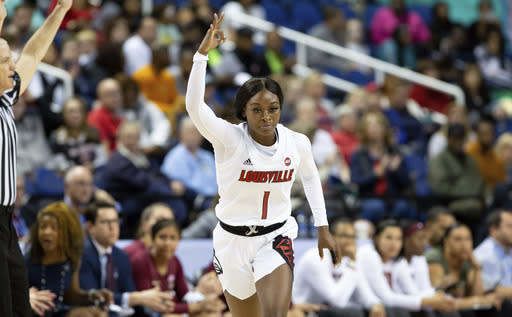 FILE - In this Saturday, March 7, 2020, file photo, Louisville's Dana Evans (1) reacts after hitting a 3-pointer during an NCAA college basketball game at the Atlantic Coast Conference women's tournament against Florida State in Greensboro, N.C. Evans is the preseason ACC player of the year. (AP Photo/Ben McKeown, File)