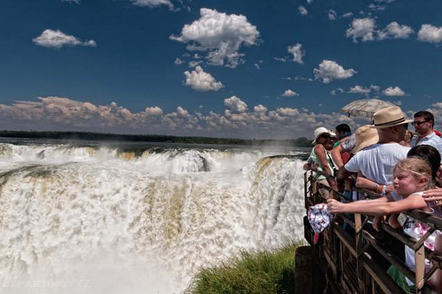 A viewing platform at Iguazu Falls. Photo: Joshua Paul Shefman/Flickr - Brazil has about 20 percent of the falls while the balance 80 percent belongs to Argentina. There are numerous falls and walkways that you can see but you cannot leave without seeing the Devil's Throat, the point where the falls are at their highest and deepest.