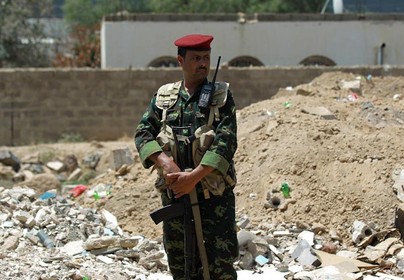 A Yemeni soldier stands guard outside a tunnel that was dug underneath a neighbourhood close to the residential compound of Yemen's former president Ali Abdullah Saleh, in Sanaa on August 16, 2014
