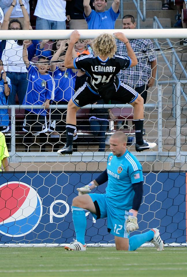 PALO ALTO, CA - JUNE 30: Steven Lenhart #24 of the San Jose Earthquakes scores a goal and celebrates by doing pullups over the head of goal keeper Josh Saunders #12 of the Los Angeles Galaxy in the first half of their MLS game at Stanford Stadium on June 30, 2012 in Palo Alto, California. (Photo by Thearon W. Henderson/Getty Images)