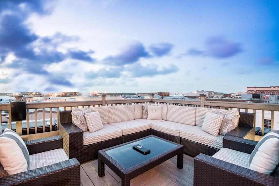 <p><strong>What's the big picture?</strong><br> Galveston's only open-air rooftop bar has views of both the harbor and downtown. The atmosphere is elevated (for a party place like Galveston) but relaxed. And let's face it: who doesn't want to sip cocktails on a rooftop while on vacation?</p> <p><strong>So what's the crowd like?</strong><br> A mix of hotel guests and locals.</p> <p><strong>What's on the drinks menu?</strong><br> Great craft beer (including Karbach from Houston) and signature cocktails like a rosemary gimlet.</p> <p><strong>Is there anything to eat?</strong><br> Not much. There are limited snacks like cheese and nuts, but you don't want to come here needing a full meal.</p> <p><strong>What's the deal with the service?</strong><br> This bar gets crowded, but even when the staff is busy, everyone manages to stay friendly and accommodating.</p> <p><strong>Bottom line—what are we coming here for?</strong><br> With just the right breeze and killer views, Tremont House is a sunset stop—a great place to escape the hustle and bustle before walking to dinner nearby.</p>