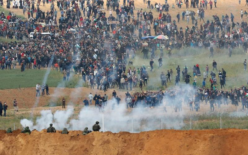 Israeli soldiers killed 16 Palestinians and wounded hundreds more on Friday when a major demonstration led to clashes along the border with the Gaza Strip (AFP Photo/Jack GUEZ )