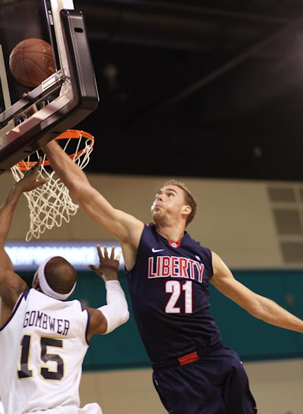Liberty's Joel Vander Pol(21) tries to block the shot of Charleston Southern's Paul Gomber (15) in second half NCAA basketball action at the Big South Conference Championship Sunday March 10, 2013 in Conway, S.C. (AP Photo/Willis Glassgow)