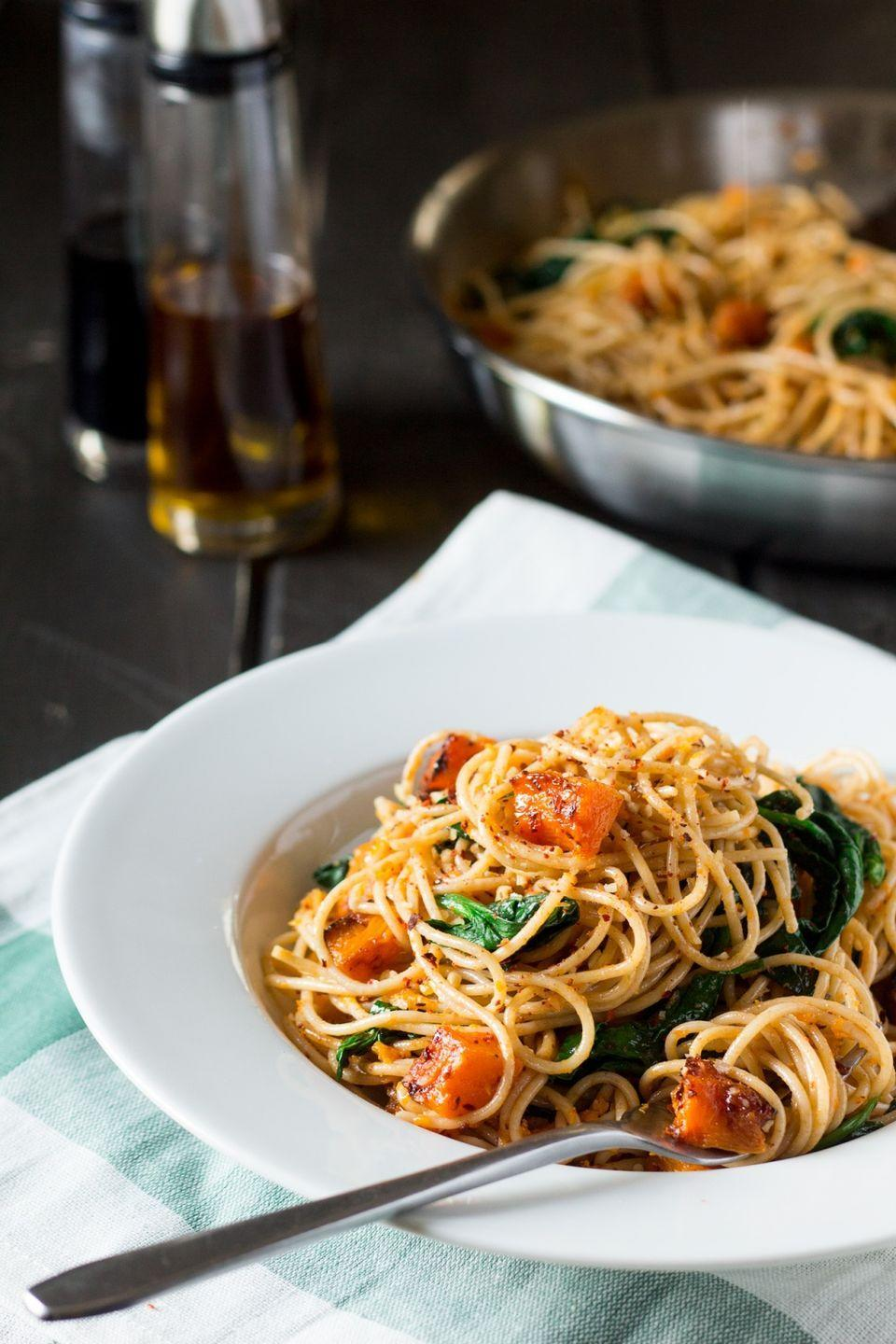 """<p>Bring bold flavors to your table in just 15 minutes with this spectacular spaghetti recipe of roasted pumpkin, spinach, and walnuts.</p><p><strong>Get the recipe at <a href=""""http://www.lazycatkitchen.com/pumpkin-spinach-and-walnut-spaghetti/"""" rel=""""nofollow noopener"""" target=""""_blank"""" data-ylk=""""slk:Lazy Cat Kitchen"""" class=""""link rapid-noclick-resp"""">Lazy Cat Kitchen</a>.</strong></p>"""