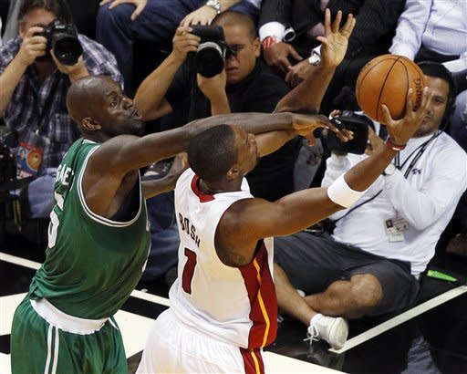 Miami Heat's Chris Bosh (1) is fouled by Boston Celtics' Kevin Garnett (5) during the first half of Game 5 in their NBA basketball Eastern Conference finals playoffs series, Tuesday, June 5, 2012, in Miami. (AP Photo/Wilfredo Lee)