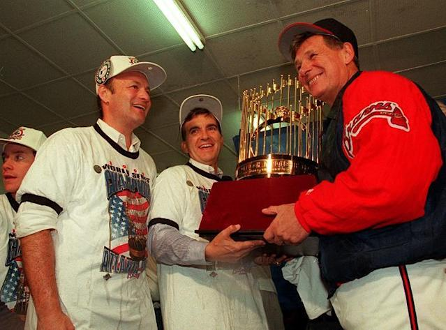 Braves president Stan Kasten, general manager John Schuerholz, and manager Bobby Cox celebrates after winning the 1995 World Series. (AP)