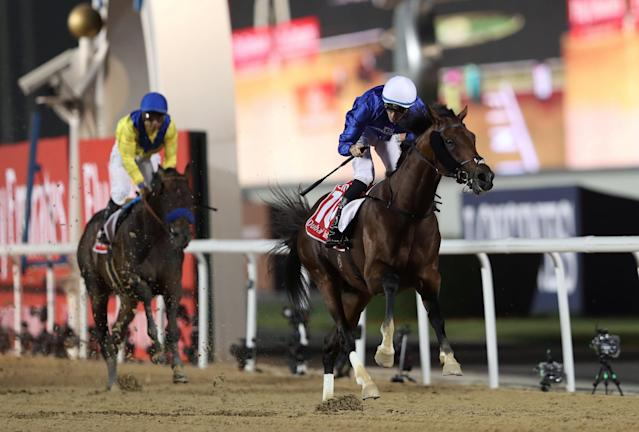 Horse Racing - Dubai World Cup 2018 - Meydan Racecourse, Dubai - United Arab Emirates - March 31, 2018 - Christophe Soumillon rides Thunder Snow from Ireland to the finish line to win the Final Race. REUTERS/Ahmed Jadallah