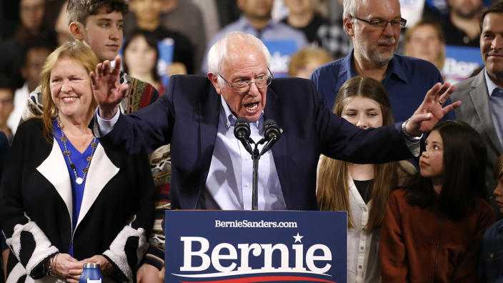 Sen. Bernie Sanders, accompanied by his wife, Jane, left, addresses supporters at his Super Tuesday night rally in Essex Junction, Vermont, on March 3. (Caitlin Ochs/Reuters)