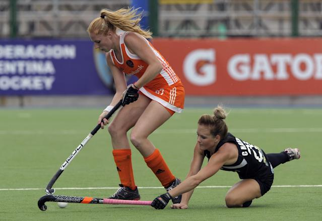 The Netherlands' Margot Van Geffen (L) vies for the ball with New Zealand's Charlotte Harrison during their Champions Trophy 2012 quarterfinals field hockey match in Rosario, Santa Fe, Argentina, on February 2, 2012. AFP PHOTO / Juan Mabromata (Photo credit should read JUAN MABROMATA/AFP/Getty Images)