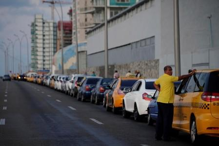 Cars line up for gas at the seafront Malecon in Havana