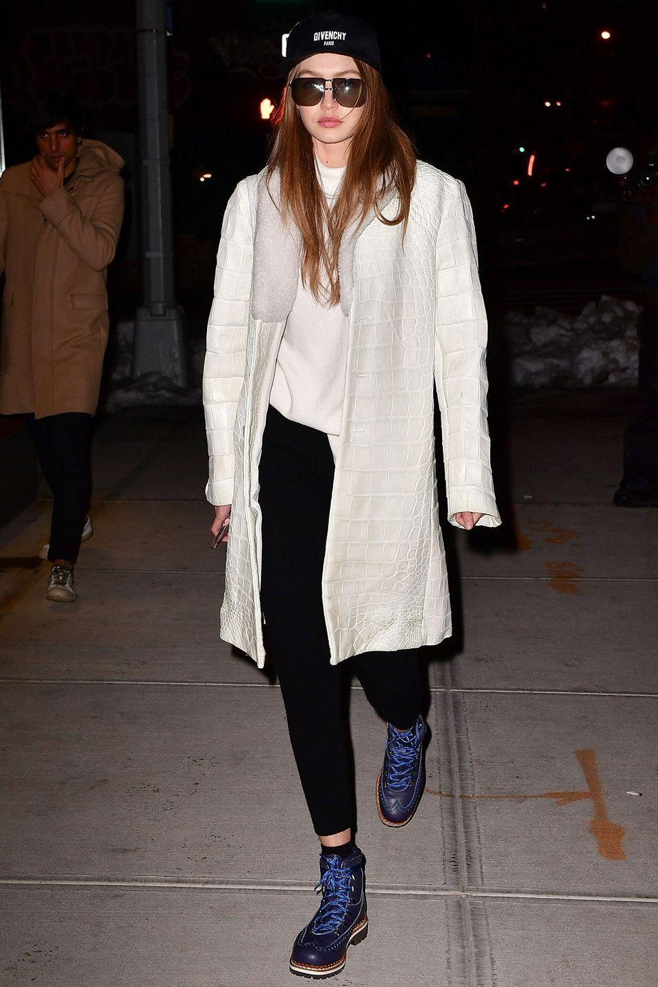 <p>In a Givenchy baseball cap, Stephanie Rad white oversized turtleneck, black leggings, white leather shearling, Tabitha Simmons lace-up boots and sunglasses while leaving The Smile in NYC.</p>