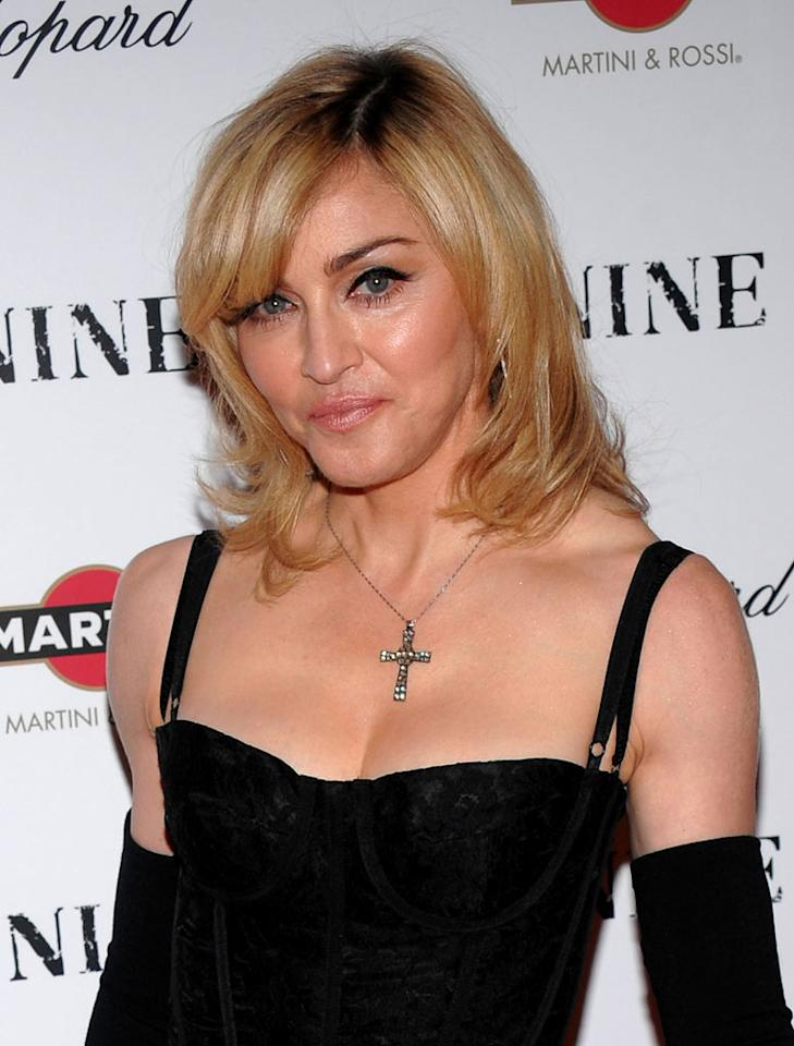 "Madonna is doing a full-body overhaul to the tune of about $150,000, reports the <i>Daily Star</i>. The newspaper claims that as an early gift to herself for her August birthday, the Material Girl is dropping a considerable sum on plastic surgery that will include an eye lift, lip fillers, Lipo Sculpt, and a boob job. Check out <a href=""http://www.gossipcop.com/madonna-plastic-surgery-birthday/"" target=""new"">Gossip Cop</a> for the full scoop on Madonna's summer surgery schedule. Dimitrios Kambouris/<a href=""http://www.gettyimages.com/"" target=""new"">GettyImages.com</a> - December 15, 2009"