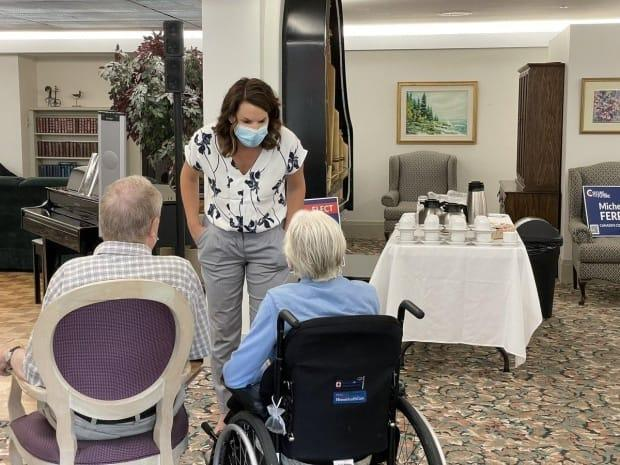 Michelle Ferreri, the Conservative candidate for Peterborough–Kawartha, posted a photo on Twitter of her campaigning with seniors at the Princess Gardens Retirement Residence. Her campaign said Ferreri has received only one shot of the COVID-19 vaccine but is taking a daily rapid test. (Michelle Ferreri/Twitter - image credit)