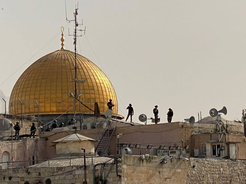 FILE PHOTO: Israeli security forces on rooftops in front of the Dome of the Rock in Jerusalem's Old City