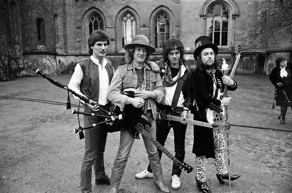 Slade (Don Powell, Noddy Holder, Jim Lea and Dave Hill) filming a new video at Eastnor Castle, near Ledbury, 26th January 1984. (Photo by Birmingham Post and Mail Archive/Mirrorpix/Getty Images)