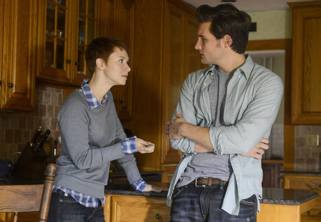 "Emma (Valorie Curry) hands Jacob (Nico Tortorella) a knife in the ""Mad Love"" episode of ""The Following."""