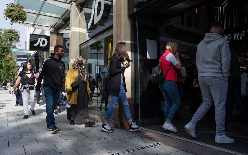 Shoppers queue outside JD sports as non-essential shops open for the first time since the start of lockdown on June 22 - Matthew Horwood/Getty Images Europe
