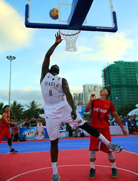 Qatar won the men's 3-on-3 basketball gold medal in the 2016 Asian Beach Games in Vietnam's central coastal city of Danang (AFP Photo/Quang Minh)