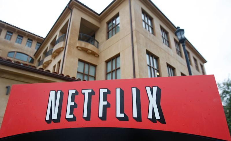 FILE - This Jan. 29, 2010, file photo, shows the company logo and view of Netflix headquarters in Los Gatos, Calif. Investors for years have seemingly adored technology stocks as much as most people love their smartphones. But Wall Street has suddenly soured on Silicon Valley and the rest of tech, triggering a stomach-churning downturn likely to leave millions queasy, should they check the damage to their investment portfolios in Oct. 2018. (AP Photo/Marcio Jose Sanchez, File)