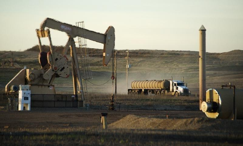 A service truck drives past an oil well on the Fort Berthold Indian Reservation in North Dakota