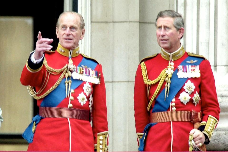Son and heir: Prince Philip and Prince Charles enjoy Trooping the Colour in 2001Getty Images