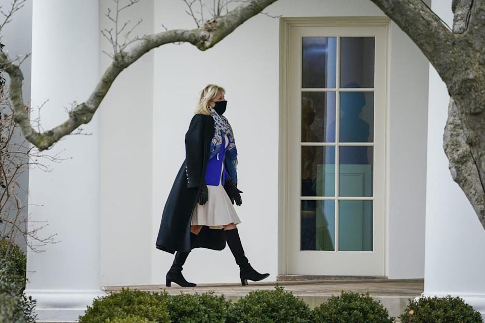 """<p>Biden has taken a fondness to <a href=""""https://www.popsugar.com/fashion/jill-biden-wearing-stuart-weitzman-boots-48177212"""" class=""""link rapid-noclick-resp"""" rel=""""nofollow noopener"""" target=""""_blank"""" data-ylk=""""slk:Stuart Weitzman's well-crafted boots"""">Stuart Weitzman's well-crafted boots</a>, sporting everything from the Milla to the famous <a href=""""https://www.popsugar.com/fashion/jill-biden-stuart-weitzman-vote-boots-47790811"""" class=""""link rapid-noclick-resp"""" rel=""""nofollow noopener"""" target=""""_blank"""" data-ylk=""""slk:5050 Vote boot"""">5050 Vote boot</a> that she wore to the polls in Delaware. She styled the former with a bright Giorgio Armani blazer jacket for an appearance at the White House in late January 2021. The Stuart Weitzman brand, currently helmed by Global Head of Design Edmundo Castillo, is committed to sustainable practices through its global house of brands <a href=""""https://www.tapestry.com/responsibility/"""" class=""""link rapid-noclick-resp"""" rel=""""nofollow noopener"""" target=""""_blank"""" data-ylk=""""slk:Tapestry"""">Tapestry</a>, and has recently chosen tennis champion, designer, and philanthropist <a href=""""https://www.popsugar.com/fashion/serena-williams-olympia-ohanian-stuart-weitzman-campaign-48194880"""" class=""""link rapid-noclick-resp"""" rel=""""nofollow noopener"""" target=""""_blank"""" data-ylk=""""slk:Serena Williams to empower customers"""">Serena Williams to empower customers</a> through its Shine Series and Footsteps to Follow campaign.</p>"""