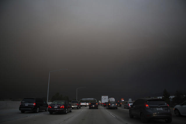 <p>Traffic makes their way south on I-15 as ash from the Holy Fire fills the air on Aug. 9, 2018 in Lake Elsinore, Calif. (Photo: Patrick Record/AP) </p>
