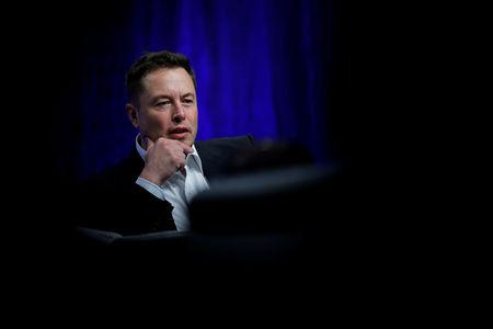 Tesla executive exits, CEO smokes pot on webcast, shares reel